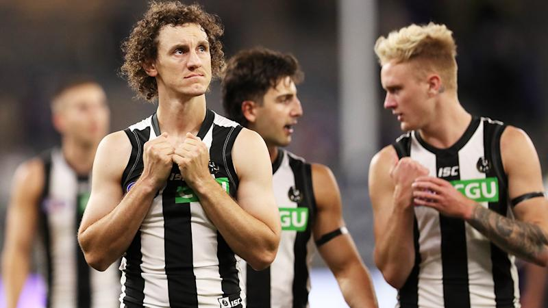 Collingwood players, pictured here looking dejected after their loss to Fremantle in the AFL.
