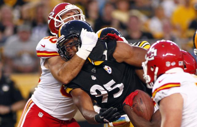 PITTSBURGH, PA - AUGUST 24: Jarvis Jones #95 of the Pittsburgh Steelers is held by Anthony Fasano #80 of the Kansas City Chiefs during the game on August 24, 2013 at Heinz Field in Pittsburgh, Pennsylvania. (Photo by Justin K. Aller/Getty Images)