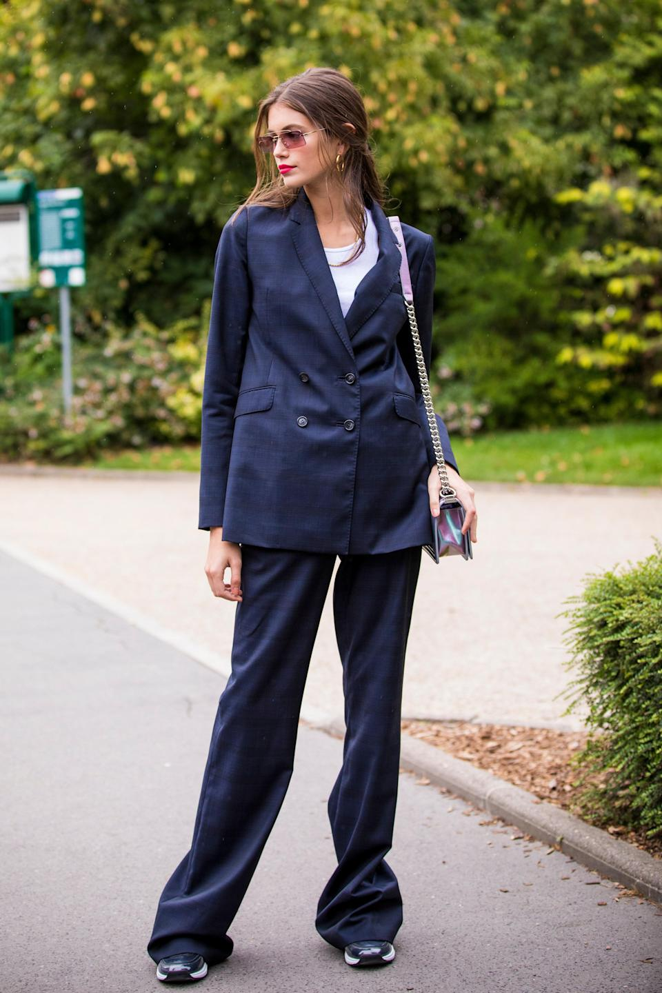 Oversized suits, sneakers and a red lip make for an unforgettable combo.