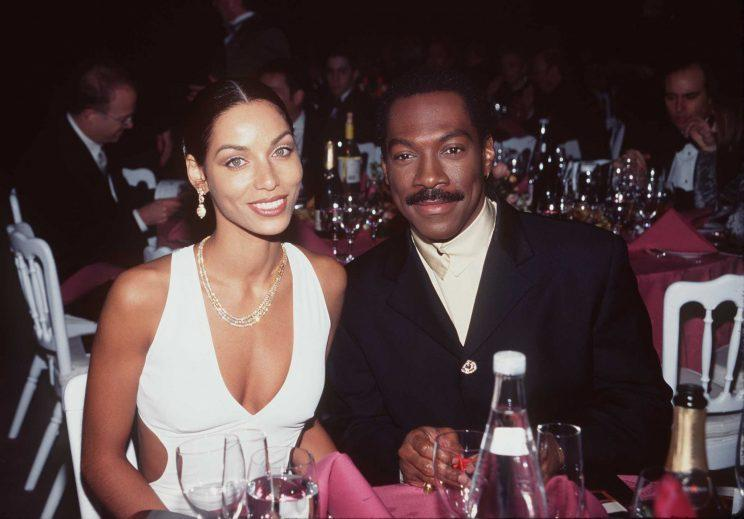 Nicole Mitchell Murphy and Eddie Murphy pictured in early 1997. They survived the scandal, but later divorced. (Photo: Getty Images)