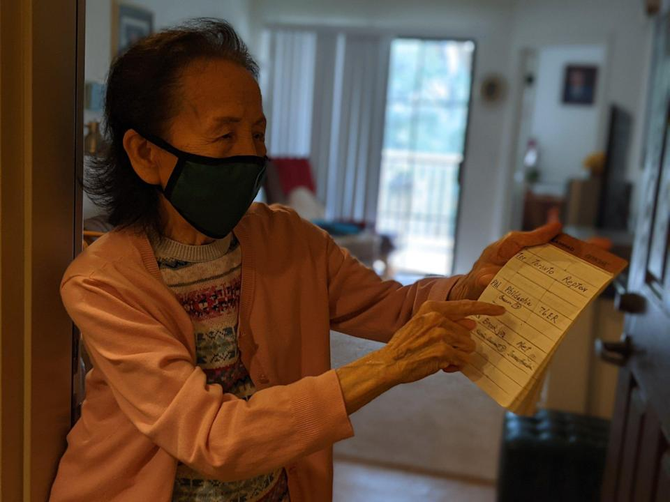 Lili Gu's grandmother points to her list of favorite NBA players.