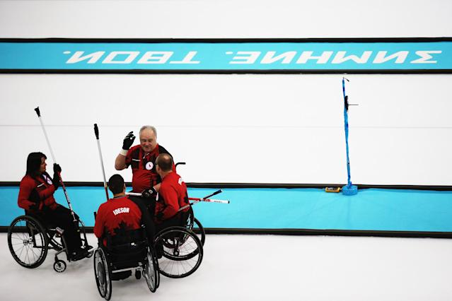 SOCHI, RUSSIA - MARCH 08: Canada meet between ends during the wheelchair curling mixed round robin match between Canada and Russia at the Ice Cube Curling Center on March 8, 2014 in Sochi, Russia. (Photo by Hannah Peters/Getty Images)