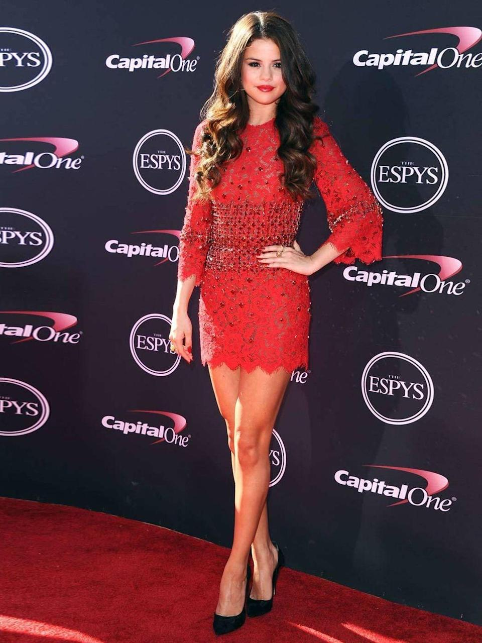 <p>Selena Gomez is wearing a bright red Dolce & Gabbana dress for the ESPY Awards, July 2013.</p>