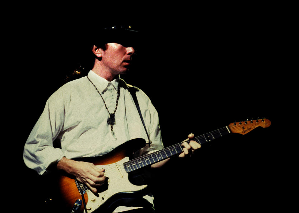 The Edge of U2 performs on stage on the Joshua Tree tour, Vorst Nationaal, Brussels, Belgium, 8th July 1987. He is playing a Fender Stratocaster guitar. (Photo by Rob Verhorst/Redferns)