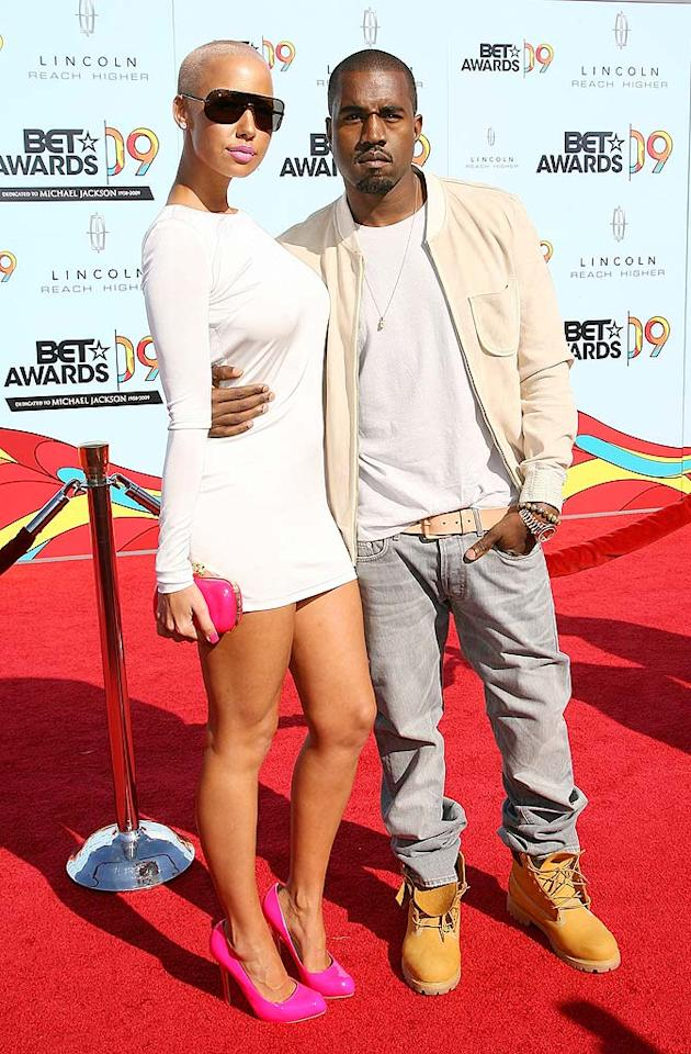 "Kanye West and his on-again/off-again gal pal, Amber Rose, looked to be on-again. The usually dapper rapper went casual in jeans, while his lady love opted for a white micro mini and pink pumps. Maury Phillips/<a href=""http://www.wireimage.com"" target=""new"">WireImage.com</a> - June 28, 2009"