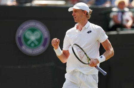Tennis - Wimbledon - All England Lawn Tennis and Croquet Club, London, Britain - July 11, 2018. South Africa's Kevin Anderson reacts during his quarter final match against Switzerland's Roger Federer. REUTERS/Andrew Boyers