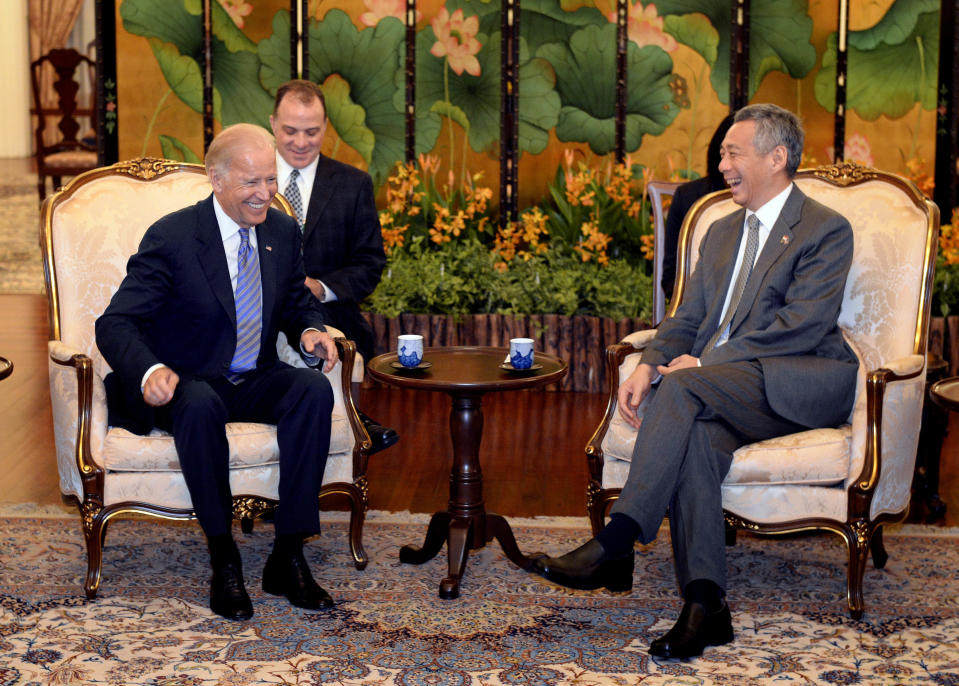 Then US vice-president Joe Biden seen sharing a laugh with Singapore's Prime Minister Lee Hsien Loong at the Istana on 26 July 2013. (PHOTO: Associated Press)