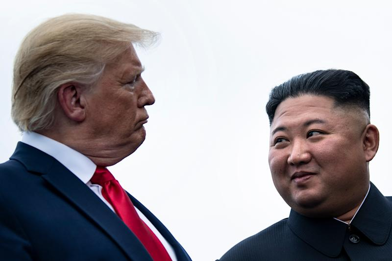 Donald Trump and Kim Jong-un talk before a meeting in the Demilitarized Zone (DMZ) on June 30, 2019. (Getty Images)