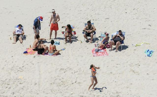 In this July 2 photo, New Jersey Gov. Chris Christie, right, uses the beach with his family and friends at the governor's summer house at Island Beach State Park. (Photo: Andrew Mills/NJ Advance Media via AP)