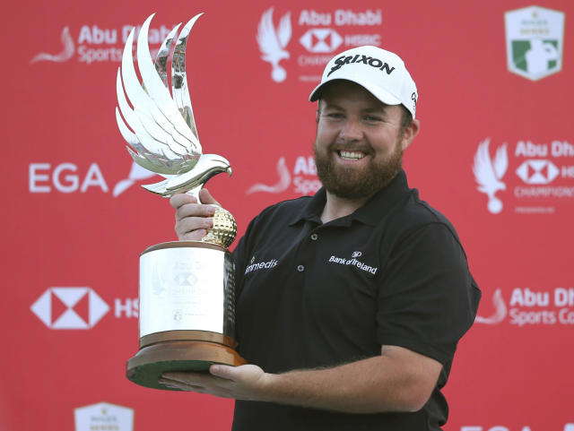 Shane Lowry of Ireland holds the trophy after winning the final round of the Abu Dhabi Championship golf tournament in Abu Dhabi, United Arab Emirates, Saturday, January 19, 2019. (AP Photo/Kamran Jebreili)