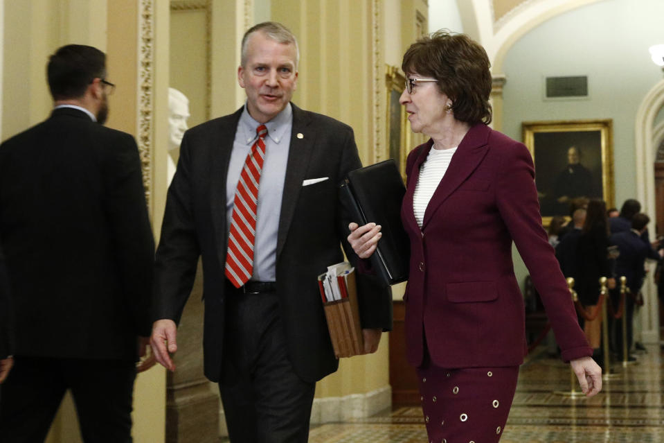 Sen. Susan Collins, R-Maine, right, walks with Sen. Dan Sullivan, R-Alaska, as they make their way to the Senate chamber for the impeachment trial of President Donald Trump at the Capitol, Wednesday, Jan. 22, 2020, in Washington. (AP Photo/Steve Helber)