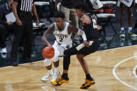 Michigan State's Rocket Watts, left, maneuvers against Purdue's Jaden Ivey (23) during the first half of an NCAA college basketball game Friday, Jan. 8, 2021, in East Lansing, Mich. (AP Photo/Al Goldis)