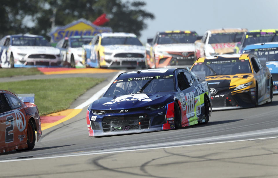 Alex Bowman (88) heads out of the Bus Stop during a NASCAR Cup Series auto race at Watkins Glen International, Sunday, Aug. 4, 2019, in Watkins Glen, N.Y. (AP Photo/John Munson)