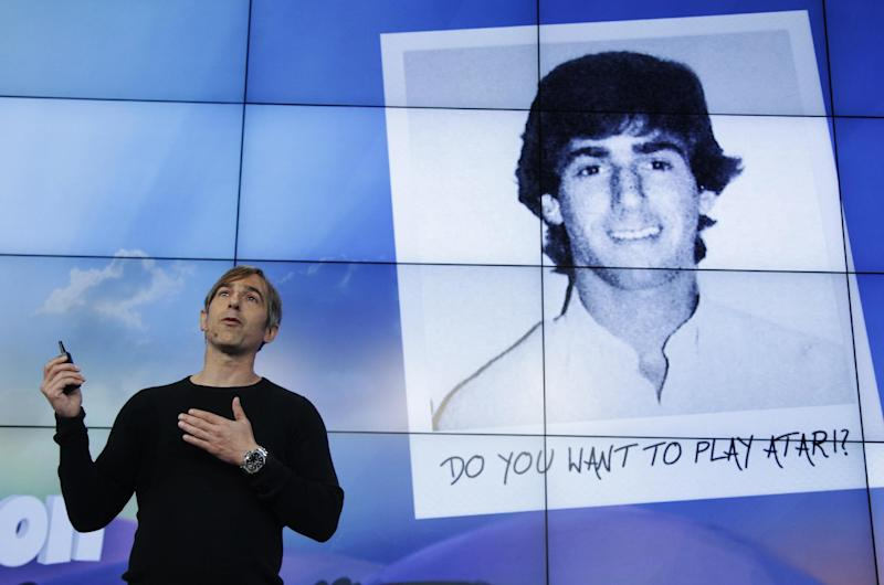 Zynga CEO Mark Pincus talks as a picture of himself as a teenager game player is shown during at an announcement at Zynga headquarters in San Francisco, Tuesday, June 26, 2012. Zynga said Tuesday it is expected to add more Web games to its digital arcade and introduce more ways to play them as it tries to lessen its dependence on Facebook and generate more revenue. (AP Photo/Paul Sakuma)