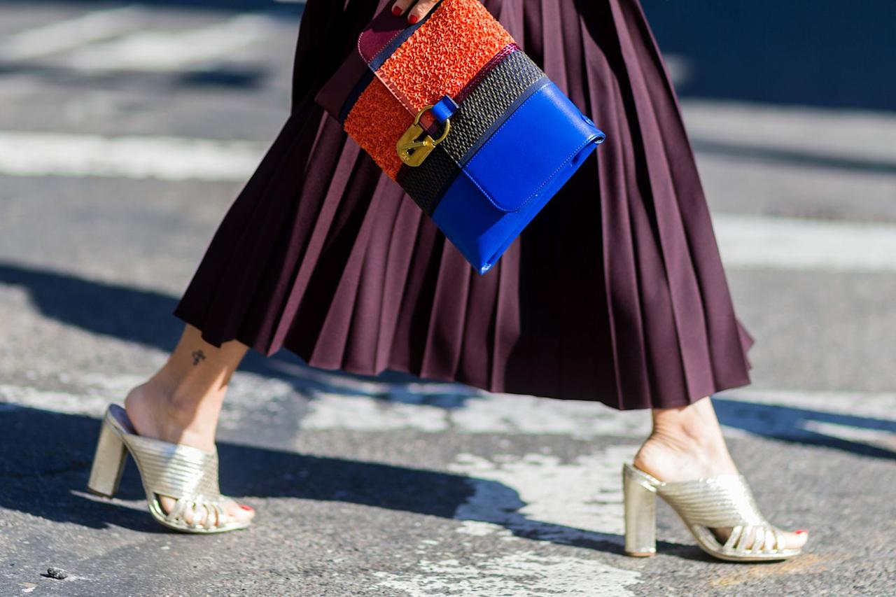 """<p>""""A metallic block heel like our <a rel=""""nofollow"""" href=""""https://www.net-a-porter.com/gb/en/product/1037527?cm_mmc=Google-ProductSearch-UK--c-_-NAP_EN_UK_PLA-_-UK+-+GS+-+Designers+-+Catch+All+-+Low--Designers_INTL&gclid=EAIaIQobChMI1L6f8Mfi2wIVRw4rCh3IGwywEAQYAyABEgJZU_D_BwE&gclsrc=aw.ds"""">Tony shoe</a> goes with everything. Because of the shape of the heel, it's universal – you can wear it to different places. It's not a stiletto where trying to walk on a lawn or on a cobbled street is difficult. A gold or silver block heel is versatile in a way that block colours – a green for example – just aren't. You can wear it at night or during the day. Champagne-colour sandals work similarly – they have such longevity and versatility, which means that you don't have to pack so much on holiday.""""<br></p>"""