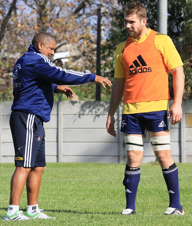 CAPE TOWN. SOUTH AFRICA - MAY 09: Stormers coach Allister Coetzee talks with Jebb Sinclair during the DHL Stormers training session and press conference from High Performance Centre in Bellville on May 09, 2012 in Cape Town, South Africa. (Photo by Ashley Vlotman/Gallo Images/Getty Images)