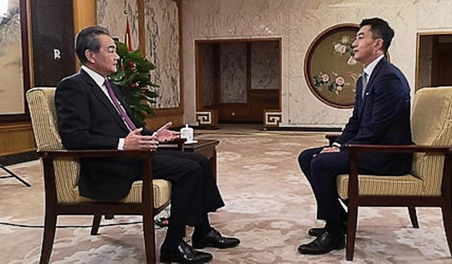 China's Foreign Minister Wang Yi (left) during his end-of-year interview with state broadcaster CCTV. Photo: Handout