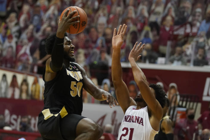 Purdue's Trevion Williams (50) goes to the basket against Indiana's Jerome Hunter (21) during the first half of an NCAA college basketball game, Thursday, Jan. 14, 2021, in Bloomington Ind. (AP Photo/Darron Cummings)