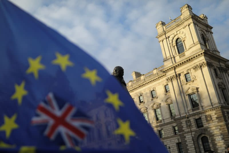 FILE PHOTO: A flag is seen outside the Houses of Parliament near the statue of former Prime Minister Winston Churchill in London