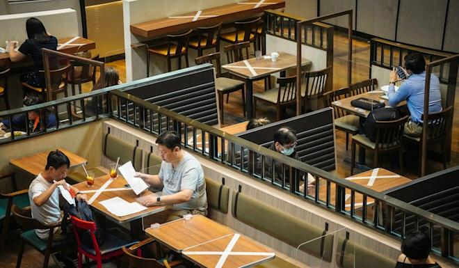 Hong Kong restaurants are now allowed to run at half their capacities and serve no more than two people per table. Photo: Sam Tsang