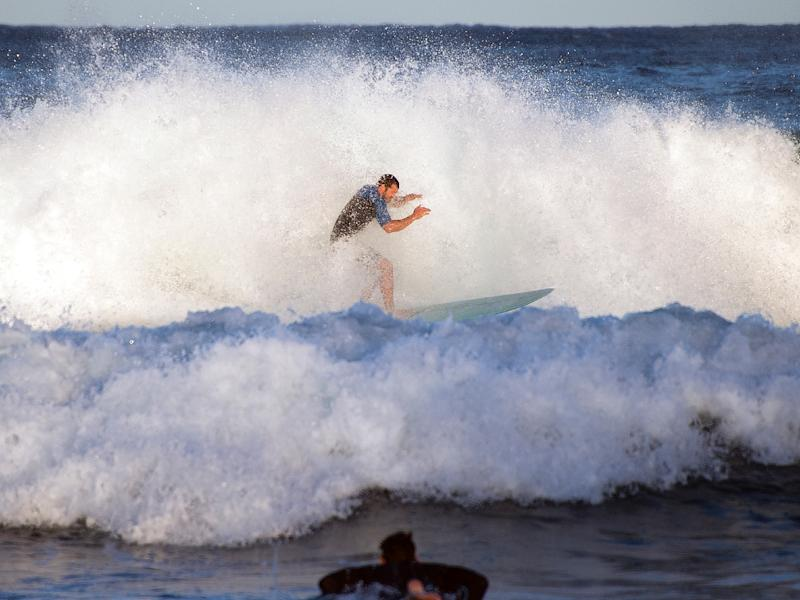 A man in his 30s was injured in Monday's shark attack off the southwest Australian coast, which prompted a three-hour suspension in the Margaret River Pro surfing competition