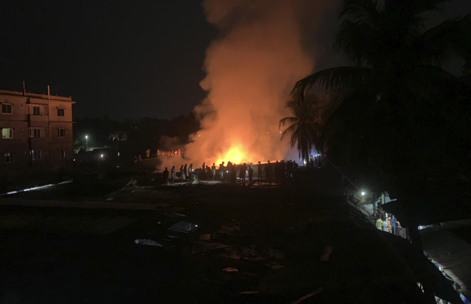 Flames rise from a fire in a makeshift market near a Rohingya refugee camp in Kutupalong, Bangladesh, Friday, April 2, 2021. The fire broke out early Friday when residents of the sprawling Kutupalong camp for Myanmar's Rohingya refugees were asleep. (AP Photo/Shafiqur Rahman)