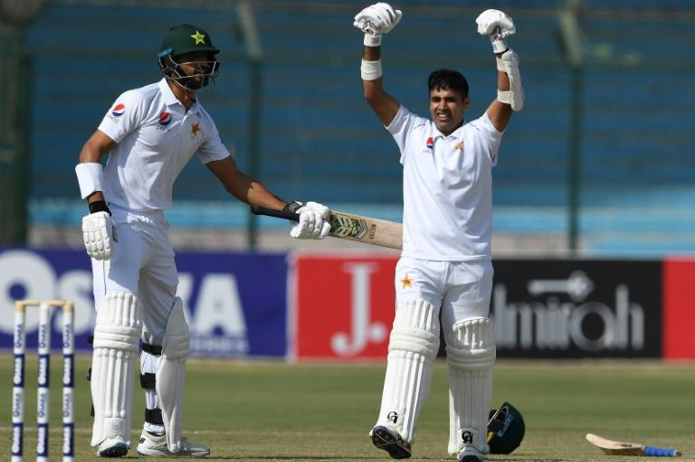 Pakistan's Abid Ali (R) celebrates with teammate Shan Masood