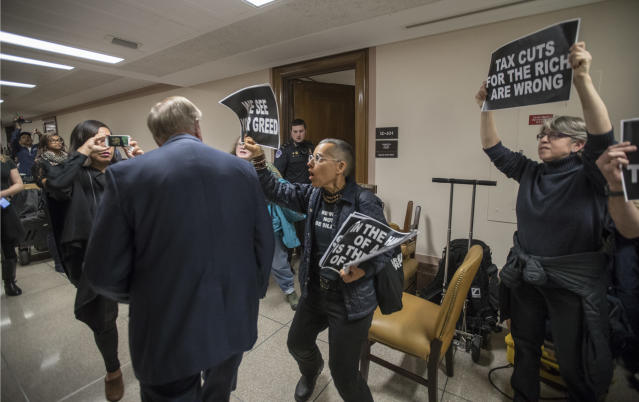 <p>Sen. Lindsey Graham, R-S.C., left, is confronted by protesters as they shout their disapproval of the Republican tax bill outside the Senate Budget Committee hearing room on Capitol Hill in Washington, Tuesday, Nov. 28, 2017. (Photo: J. Scott Applewhite/AP) </p>