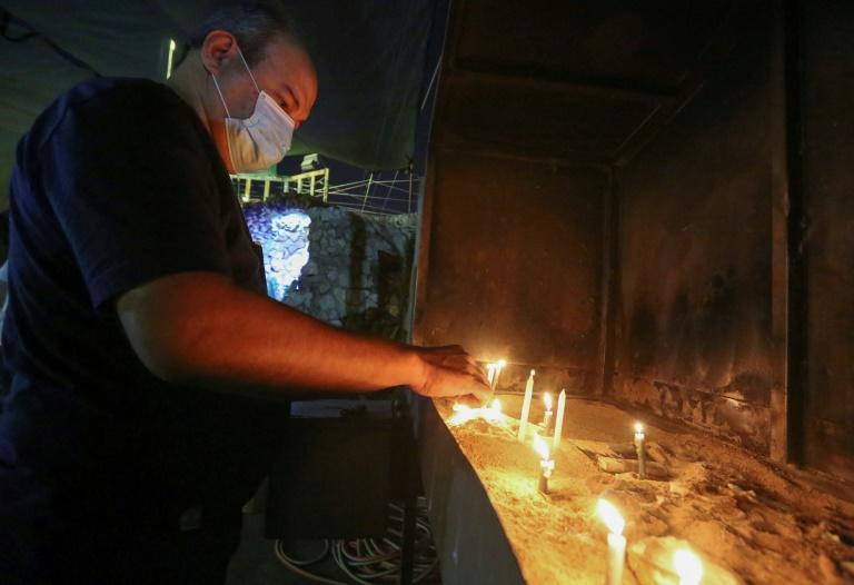A worshipper lights a candle at St. Joseph's Chaldean Cathedral in the Iraqi capital Baghdad. A few hundred thousand Christians are left in the country