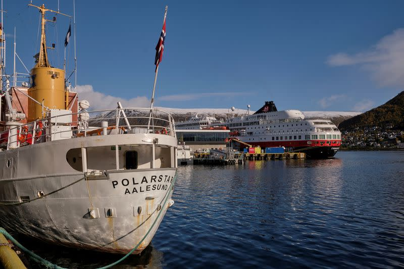 FILE PHOTO: Arctic tour ship MS Polarstar and Norwegian coastal ship MS Finnmarken are seen in the port in Tromso