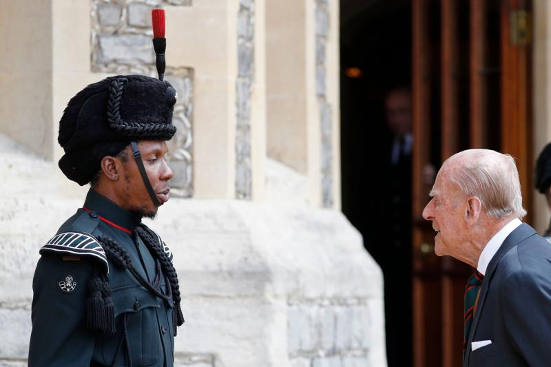 Britain's Prince Philip (R), Duke of Edinburgh speaks to a bugler during the transfer of the Colonel-in-Chief of The Rifles at Windsor castle in Windsor on July 22, 2020. - Britain's Prince Philip, Duke of Edinburgh will step down from his role as Colonel-in-Chief for the Rifles after 67 years of service. (Photo by Adrian DENNIS / POOL / AFP) (Photo by ADRIAN DENNIS/POOL/AFP via Getty Images)