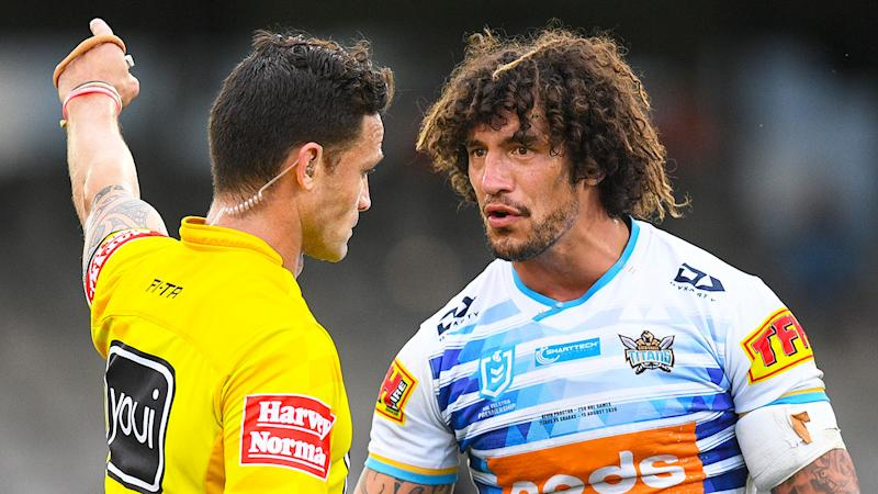 Pictured here, Kevin Proctor argues with the ref after being sent off for biting.