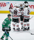 Chicago Blackhawks forward Dominik Kubalik (8) is congratulated by teammates after scoring a goal during the second period of an NHL hockey game against the Dallas Stars, Sunday, Feb. 23, 2020, in Dallas. (AP Photo/Brandon Wade)