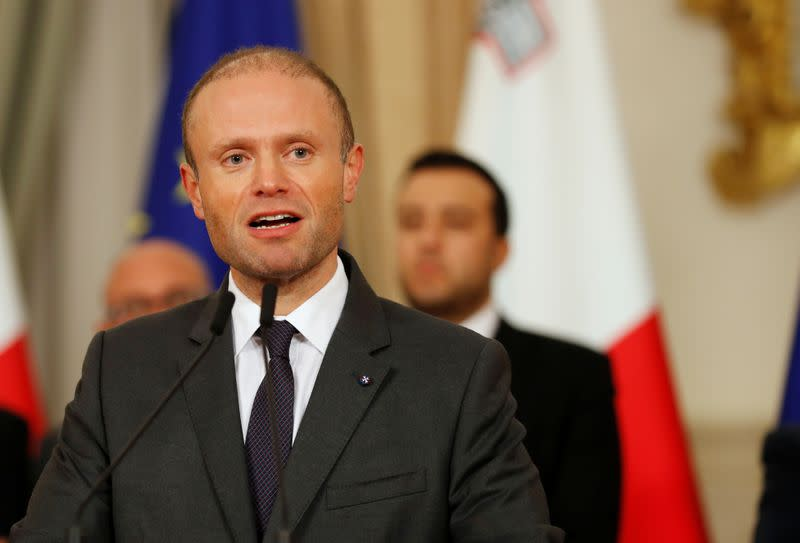 Maltese Prime Minister Joseph Muscat addresses a press conference after an urgent Cabinet meeting at the Auberge de Castille in Valletta