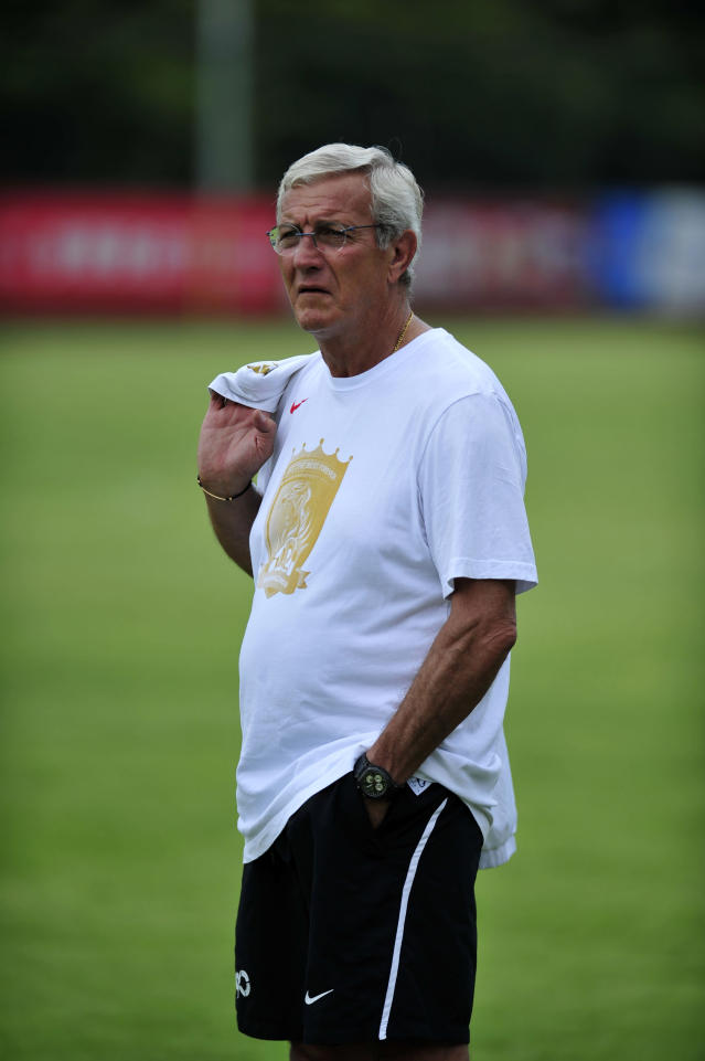 World Cup-winning coach Marcello Lippi watches his players during Paraguayan football player Lucas Barrios first training session with his new team the Guangzhou Evergrande, in Guangzhou, south China's Guangdong province on June 18, 2012. Guangzhou will take on Saudi Arabia's Al Ittihad in the AFC Champions league two-leg quarterfinals on September 19 and October 2. CHINA OUT AFP PHOTOSTR/AFP/GettyImages