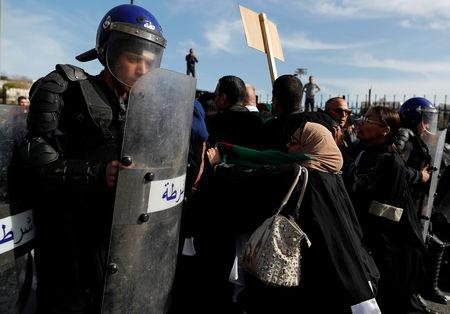 Police members stand guard as lawyers protest to denounce an offer by President Abdelaziz Bouteflika to run in elections next month but not to serve a full term if re-elected, in Algiers, Algeria March 7, 2019. REUTERS/Zohra Bensemra