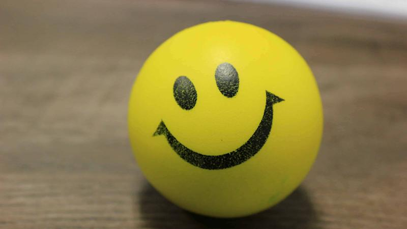 Yellow ball with a smiley face on it