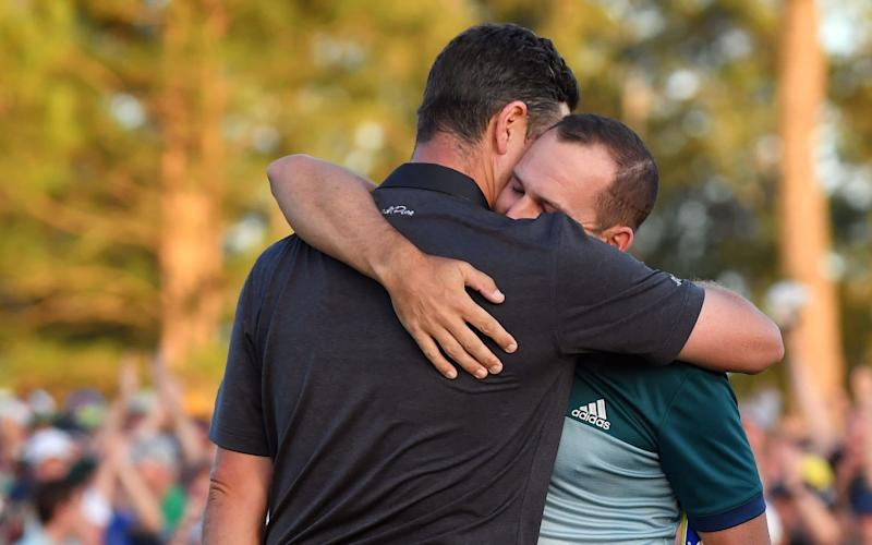 Sergio Garcia hugs Justin Rose as he wins the Green Jacket following a one-hole playoff with Rose - Credit: Rex