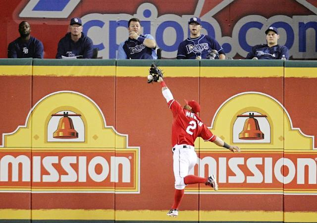 Texas Rangers' Leonys Martin (2) grabs a fly ball by Tampa Bay Rays' James Loney during the fourth inning of an American League wild-card tiebreaker baseball game Monday, Sept. 30, 2013, in Arlington, Texas. (AP Photo/Tim Sharp)