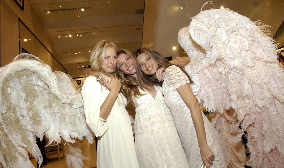 From left, supermodels Karolina Kurkova, Gisele Bundchen and Adriana Lima model self-designed angel wings at a Victoria's Secret promotional event Wednesday, May 10, 2006 in New York.  The wings, crafted by Martin Izquierdo, will be auctioned off with proceeds going to a New York-area charity for at-risk youth.  (AP Photo/Jason DeCrow)