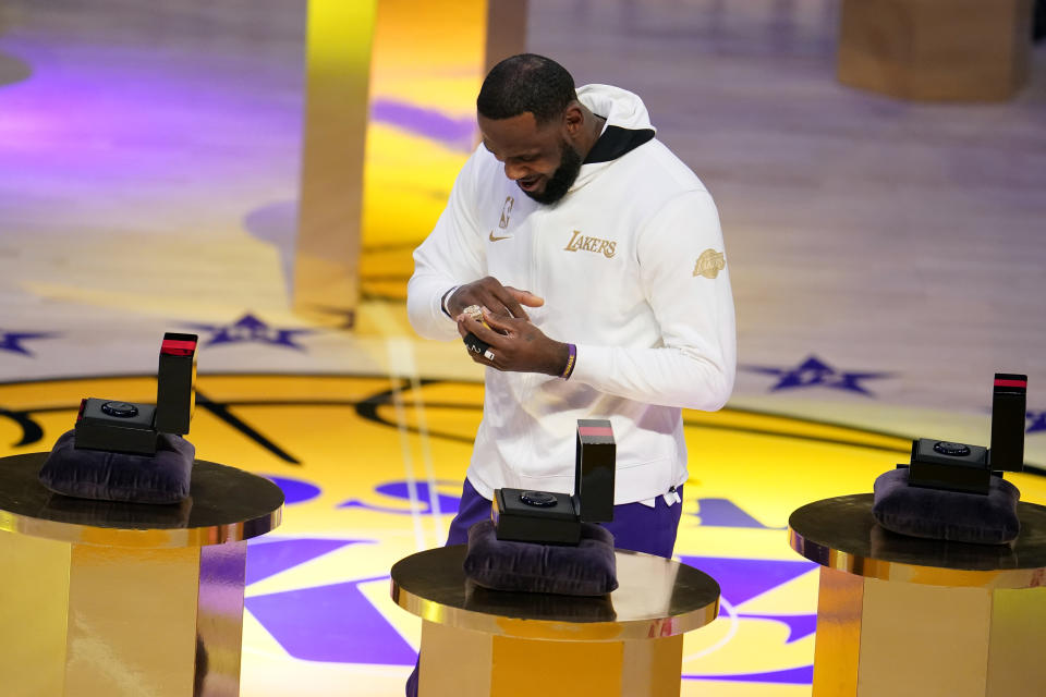 Los Angeles Lakers forward LeBron James receives his NBA championship ring
