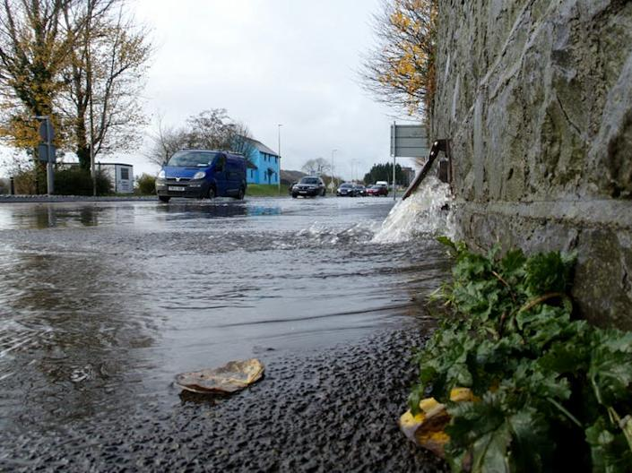 "<span class=""caption"">Water flooding from a drain in Carmarthen, UK.</span> <span class=""attribution""><a class=""link rapid-noclick-resp"" href=""https://www.shutterstock.com/image-photo/10th-november-2018-water-flowing-out-1227100885?src=JbkZ6BxPUa-mRx-qiXD7xA-1-40"" rel=""nofollow noopener"" target=""_blank"" data-ylk=""slk:J. Hime/Shutterstock."">J. Hime/Shutterstock.</a></span>"
