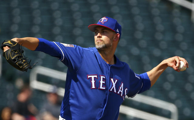 FILE - In this Feb. 25, 2019, file photo, Texas Rangers pitcher Mike Minor throws against the Cleveland Indians during the second inning of a spring training baseball game in Goodyear, Ariz. (AP Photo/Ross D. Franklin, File)