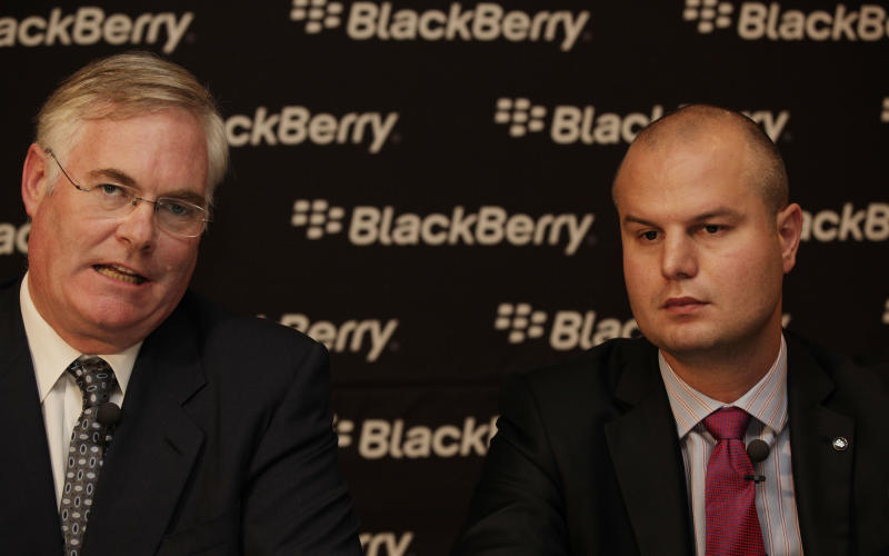 """Robert Bose, regional managing director middle east and Africa, left, and Waldi Wepener, regional director, East, central and west Africa, attend a press conference for Blackberry in Lagos, Nigeria, Tuesday, Sept. 25, 2012. The company that makes BlackBerry smartphones is looking to Africa to help its troubled sales.Officials with Toronto-based Research In Motion Ltd. told journalists in Lagos on Tuesday that its handsets are the No. 1 choice among those using smartphones in Nigeria and South Africa. Officials say that in Nigeria alone, its phones represent one out of every two phones in the market, an incredible grip on the market of Africa's most populous nation and BlackBerry phones remain such a pop culture fascination in Nigeria that it spawned a popular local film """"BlackBerry Babes."""" .(AP Photo/Sunday Alamba)"""