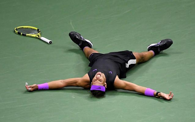 Rafael Nadal was exhausted at the end of his five-set US Open final victory overDaniil Medvedev - USA TODAY Sports