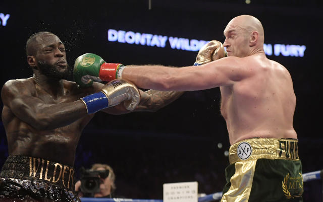 Deontay Wilder, left, and Tyson Fury will fight again on Feb. 22 in Las Vegas.