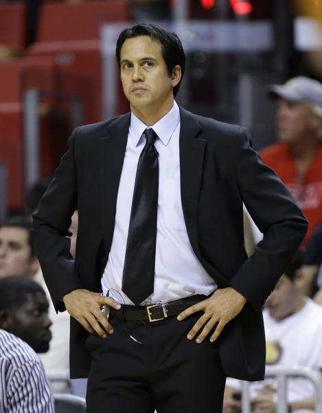 Miami Heat coach Erik Spoelstra watches during the first half of his team's NBA basketball game against the Indiana Pacers, Wednesday, Dec. 18, 2013, in Miami. (AP Photo/Lynne Sladky)