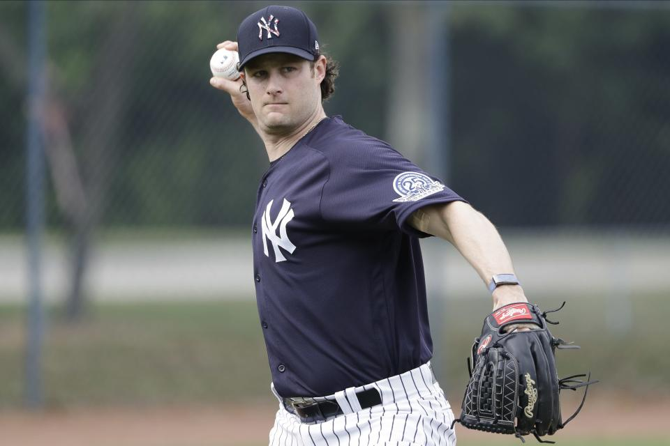 New York Yankees' Gerrit Cole throws to first base during a spring training baseball workout Thursday, Feb. 13, 2020, in Tampa, Fla. (AP Photo/Frank Franklin II)