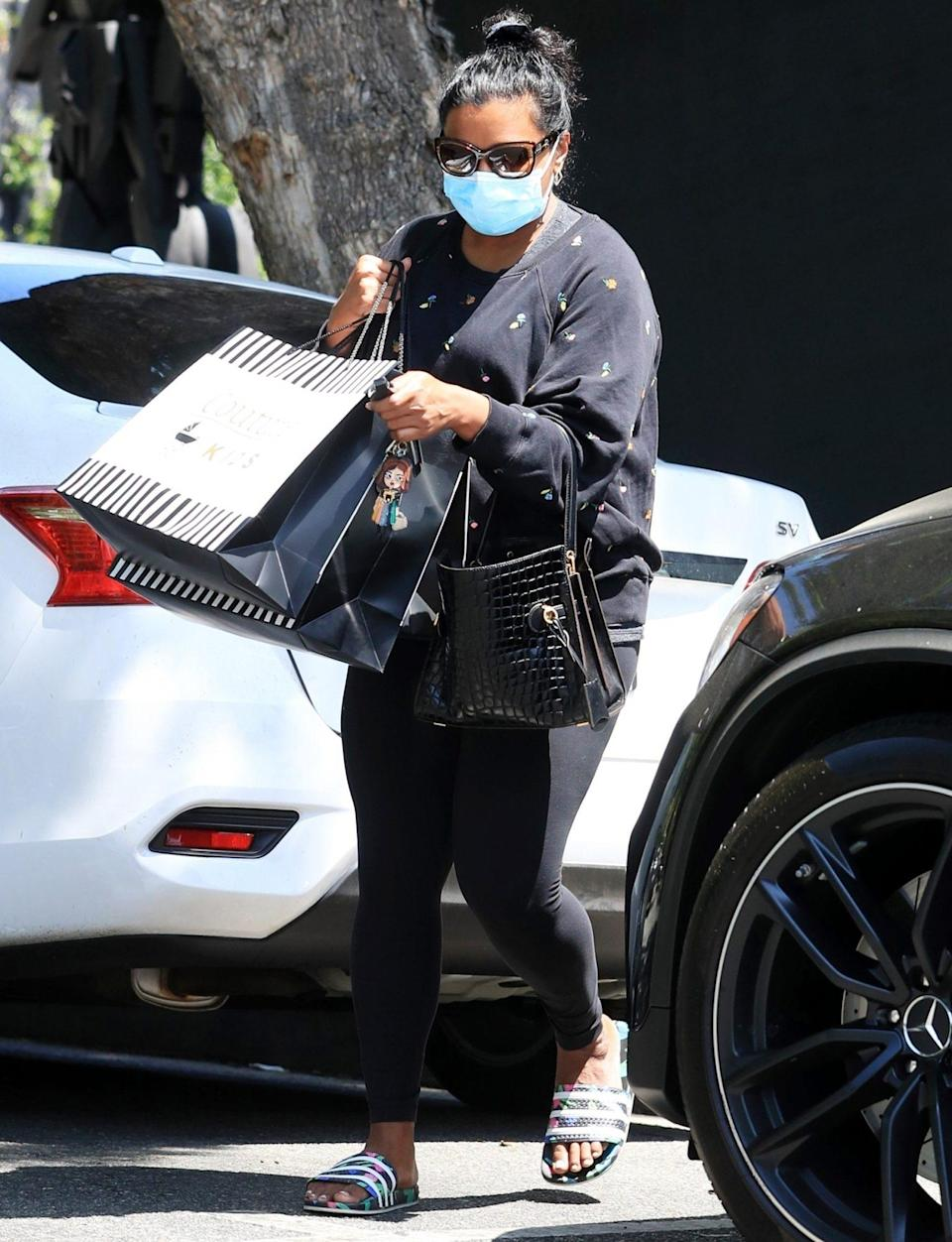 <p>Mindy Kaling heads to her car after a shopping trip at Couture Kids in West Hollywood on Wednesday.</p>