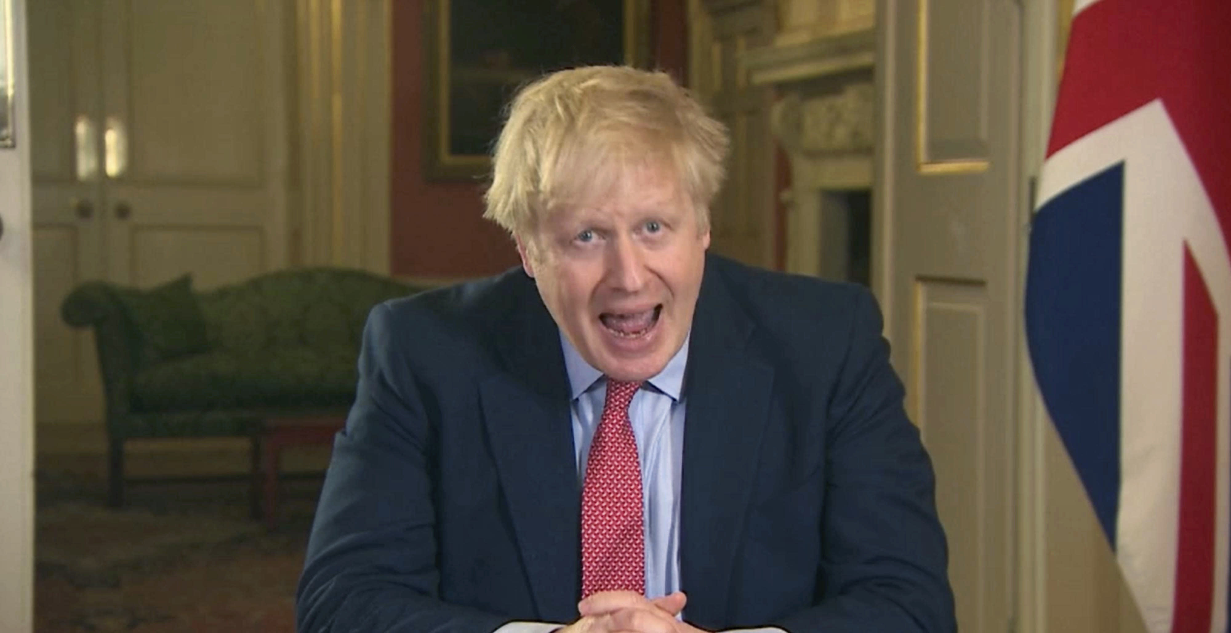 In this screen grab taken from video, Britain's Prime Minister Boris Johnson addresses the nation from 10 Downing Street, in London, Monday March 23, 2020. Johnson has ordered the closure of most retail stores and banned gatherings for three in a stepped-up response to slow the new coronavirus. The measures Johnson announced in an address to the nation on Monday night a mark a departure from the British government's until-now more relaxed approach to the worldwide COVID-19 pandemic. (PA via AP)